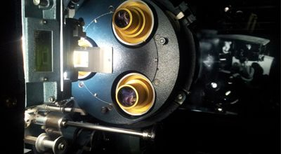 A close up picture of a cinema projector
