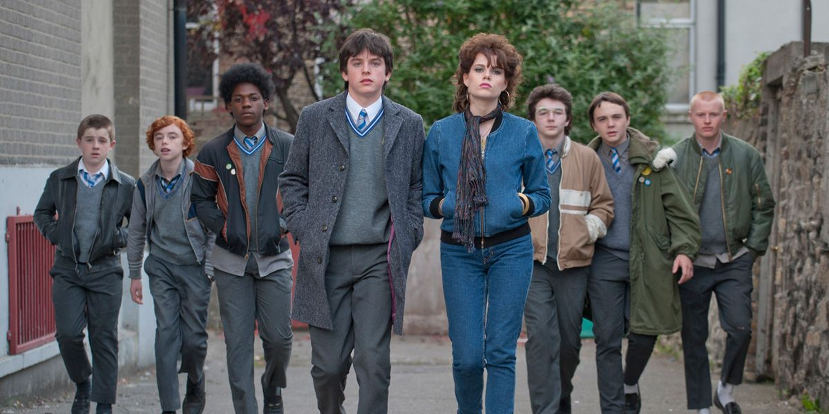 The band walk towadrs camera in Once director John Carney's film Sing Street