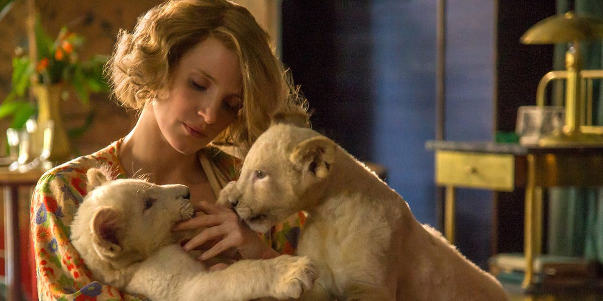 Jessica Chastain with two Lion cubs in The Zookeeper's Wife