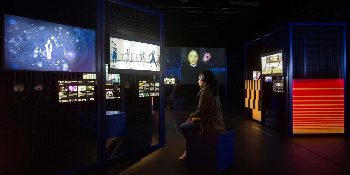 Installation shot of several screens in a gallery
