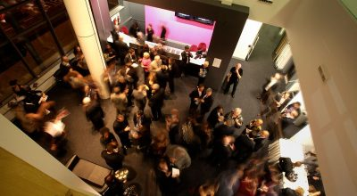 An aerial photo of a group of conference attendees in the foyer at Phoenix