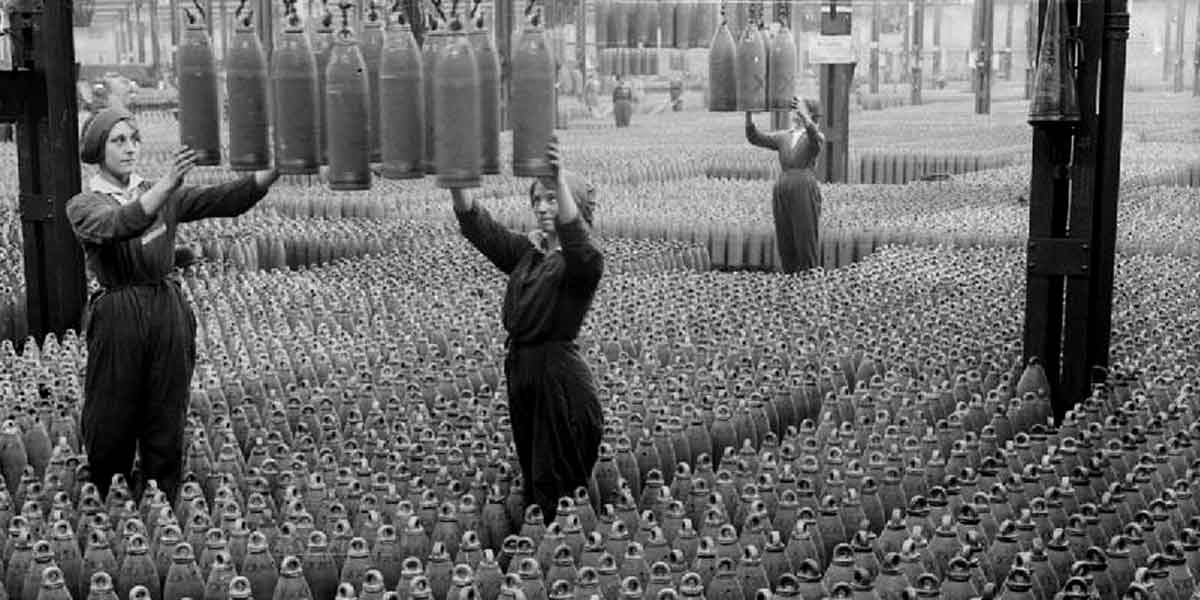 Women work in a munitions factory