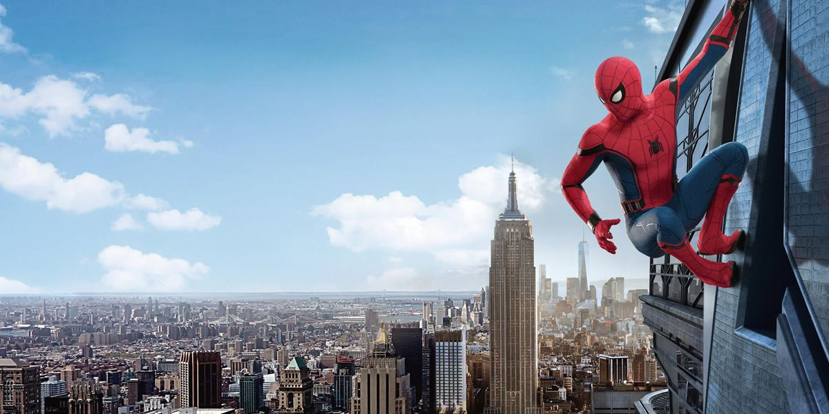 Spider-Man clings to a building in Spider-Man: Homecoming