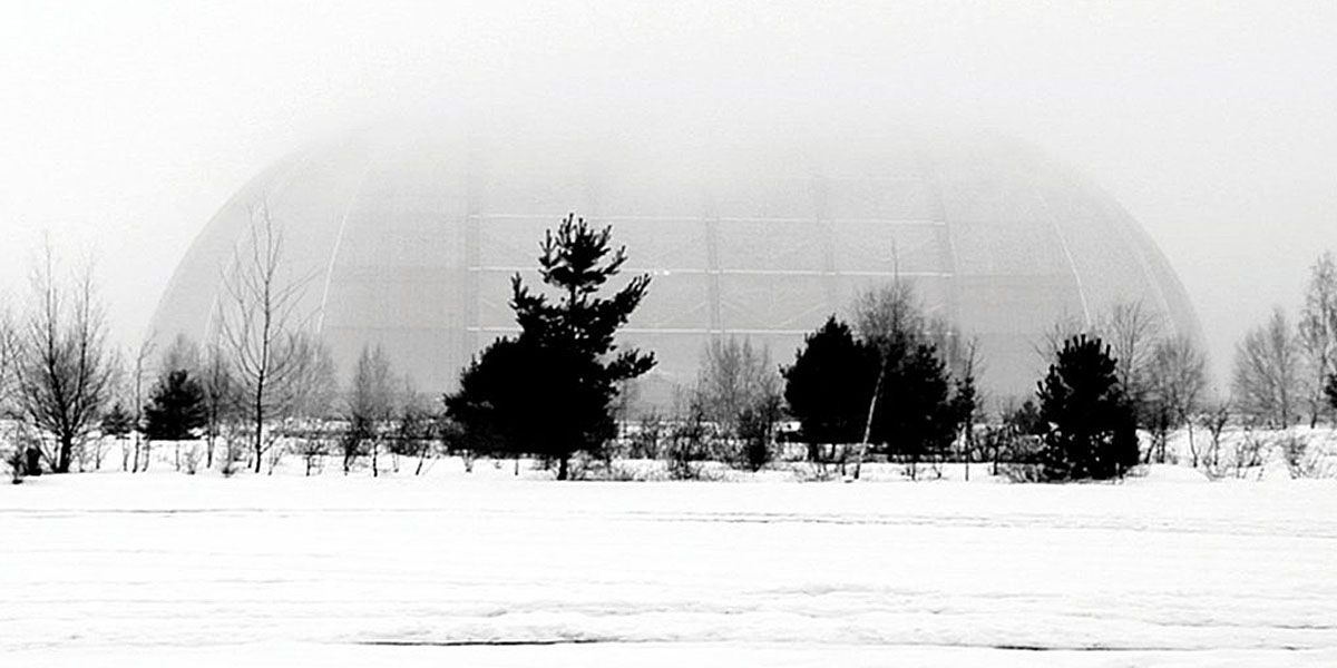 A black and white still from End Transmission of a dome in a snowy landscape