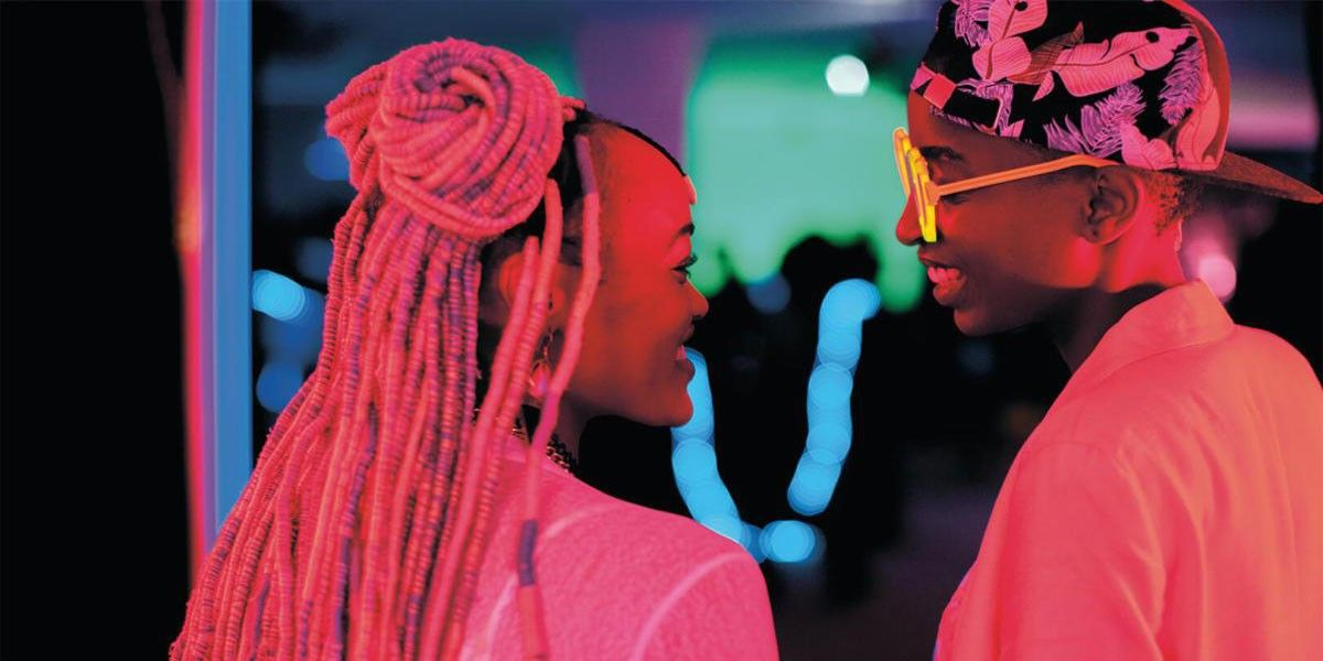 A medium shot of two girls looking at each other, from the film Rafiki