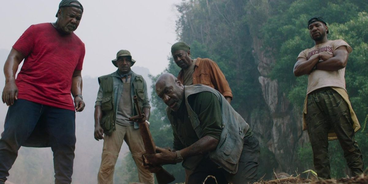 A long shot of a group of men from the film Da 5 Bloods