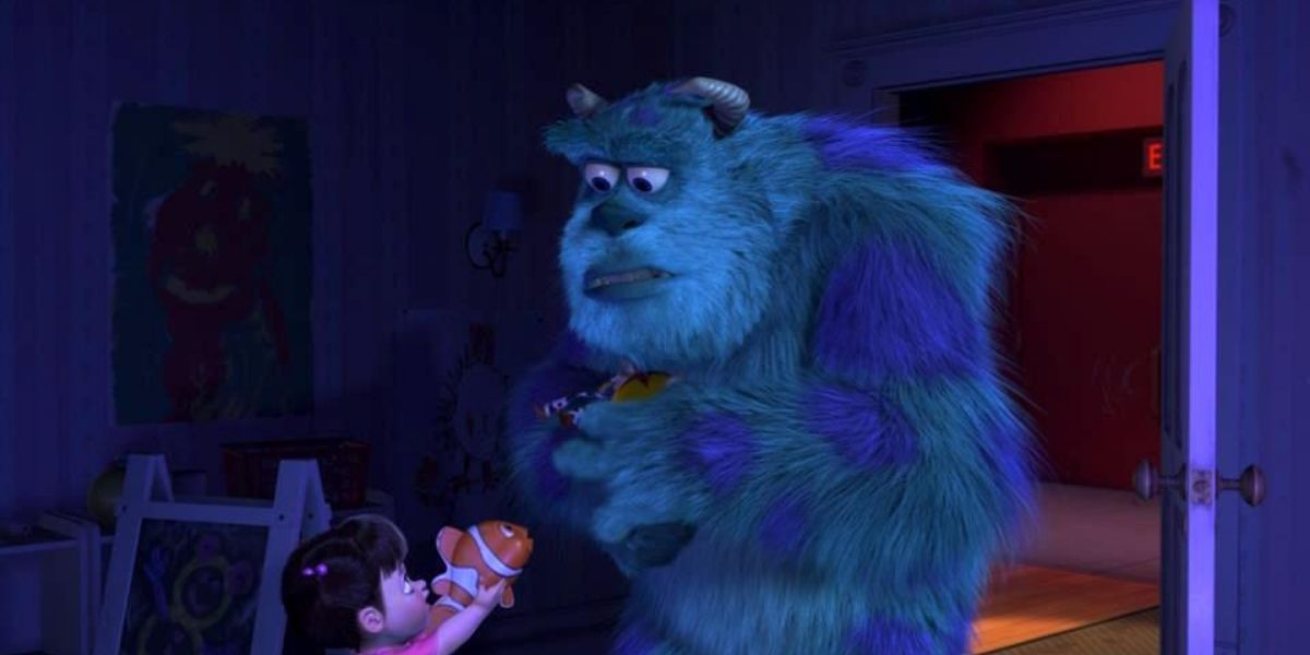 A medium shot of Boo handing Sully a Nemo toy in the animated film Monsters, Inc.
