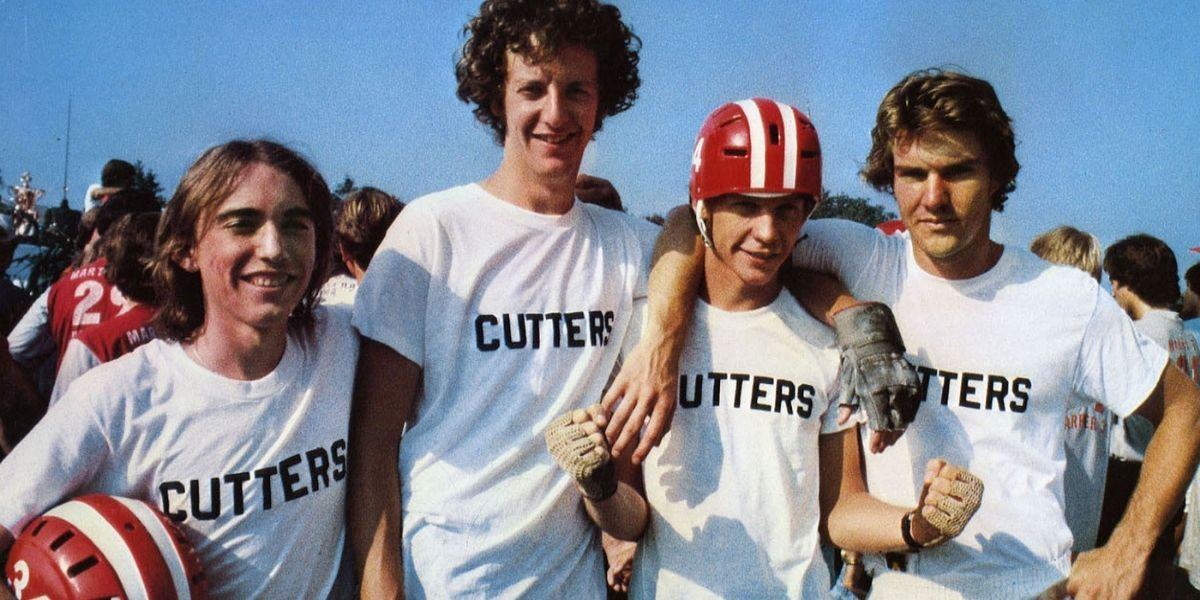A medium shot of a group of teenage boys in sports gear, from the film Breaking Away