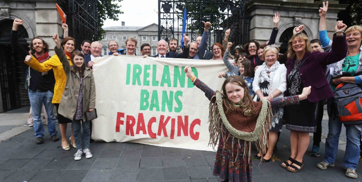 Activists display a banner saying the words 'Ireland bans fracking'