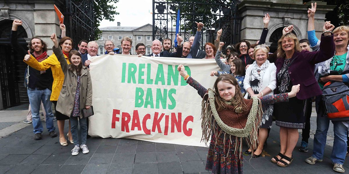 An establishing shot of activists holding up a banner with the words 'Ireland bans fracking', from the film Groundswell