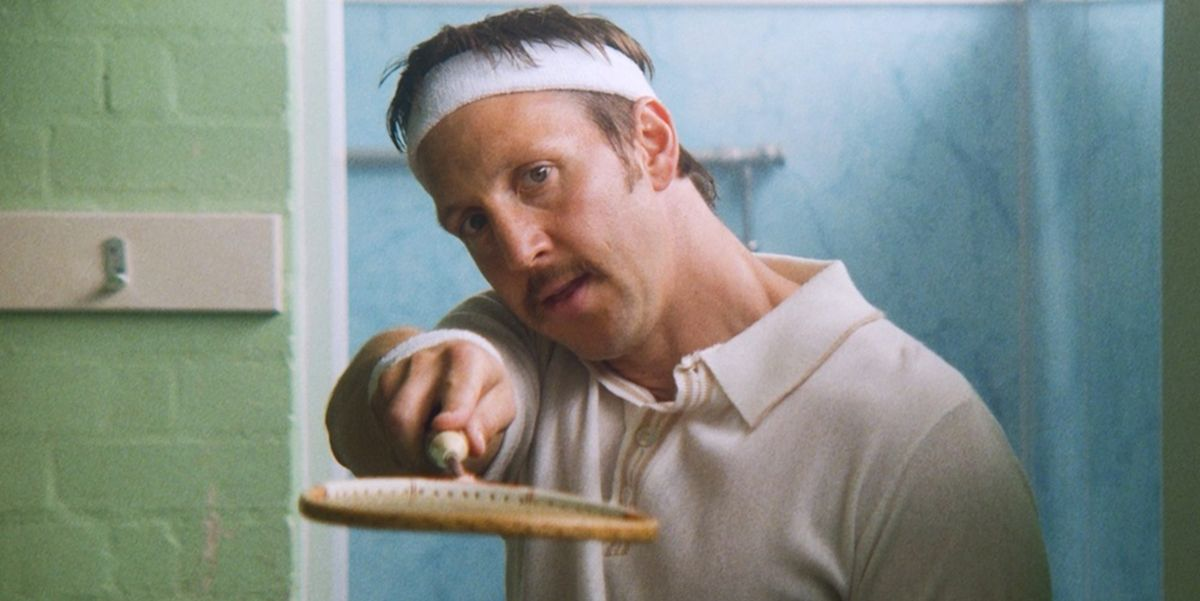 A medium shot of a man in Badminton clothes, holding a racket from the short film Shuttlecock