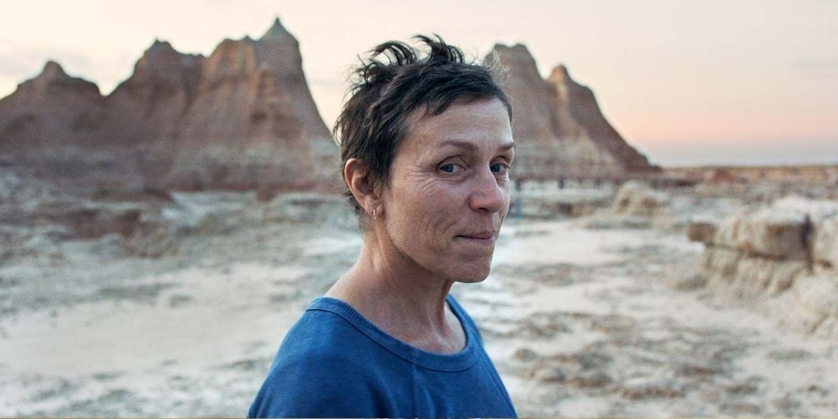 A close-up of actor Frances McDormand in front of a rocky landscape