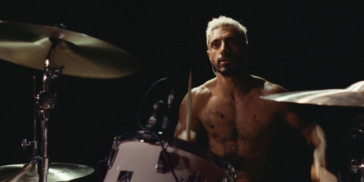 A medium shot of Riz Ahmed behind a drum set from the film Sound of Metal