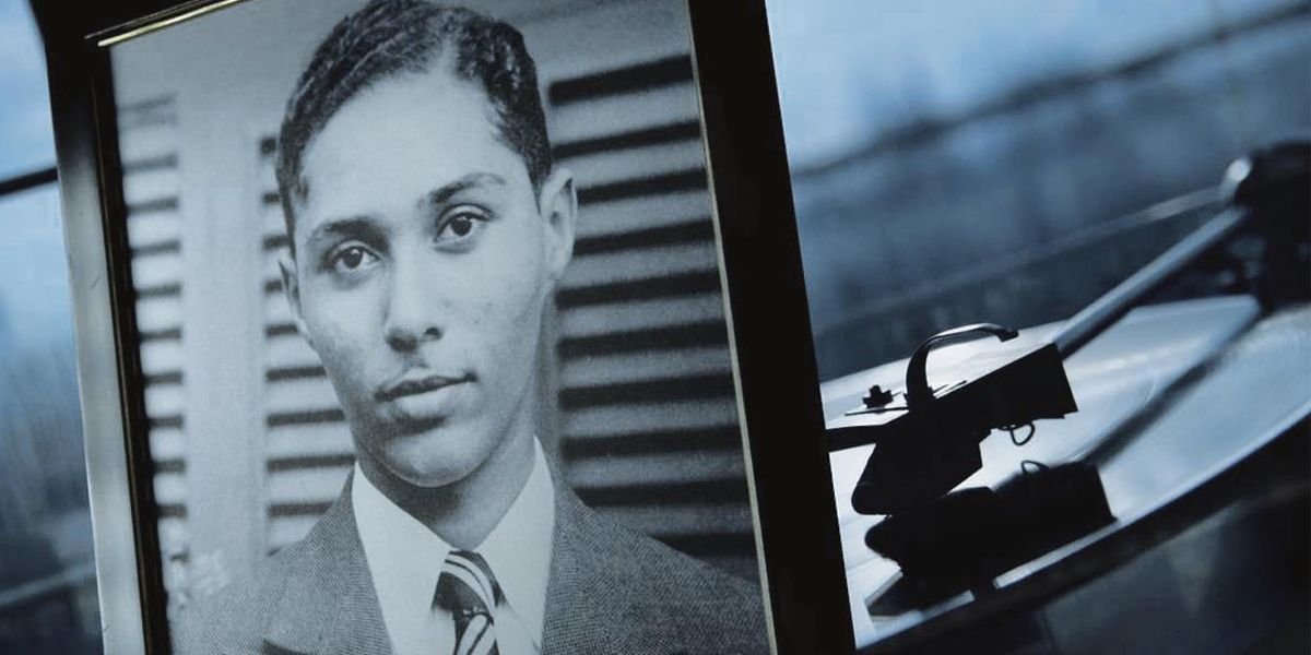 A picture of Stuart Hall, placed in front of a vinyl player.