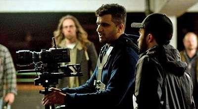 A filmmaker on set with his camera
