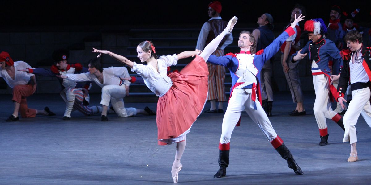 Two dancers pose in Bolshoi Ballet's The Flames of Paris