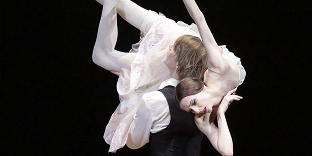 A couple of dancers entwined in Bolshoi Ballet's The Lady of the Camellias