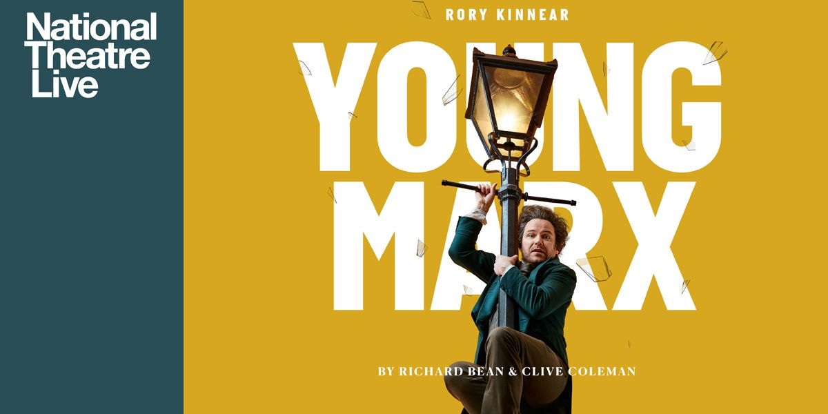 Rory Kinnear clings to a lamppost in NT Live: Young Marx