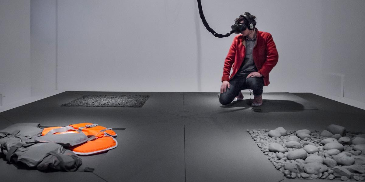 A man crouches in a virtual reality installation