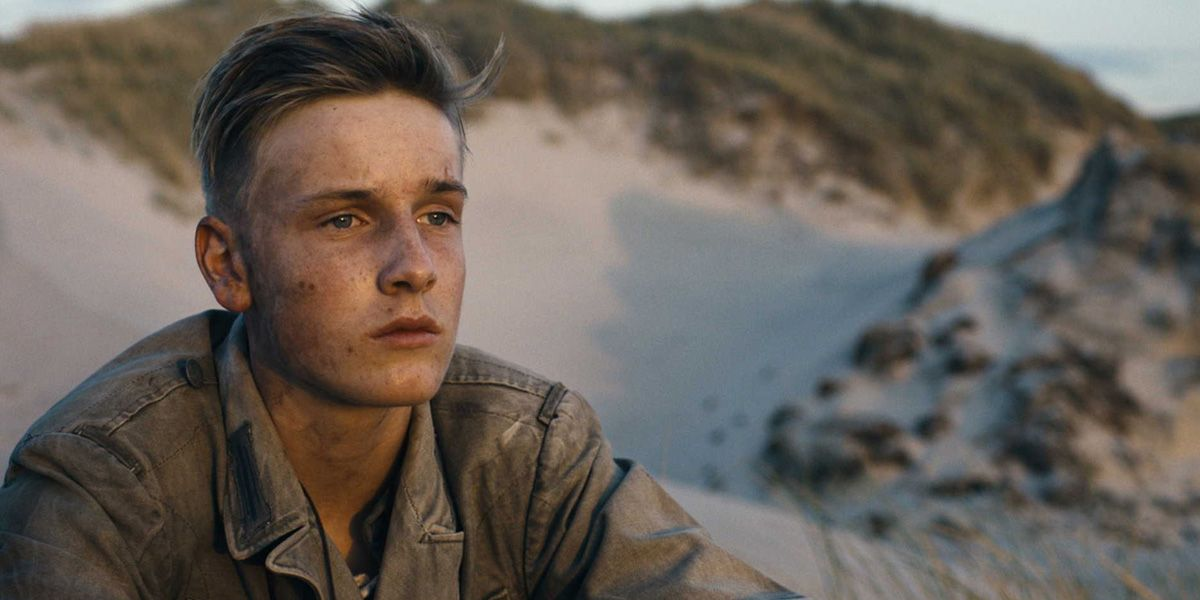A young German soldier stares into the distance in Land of Mine