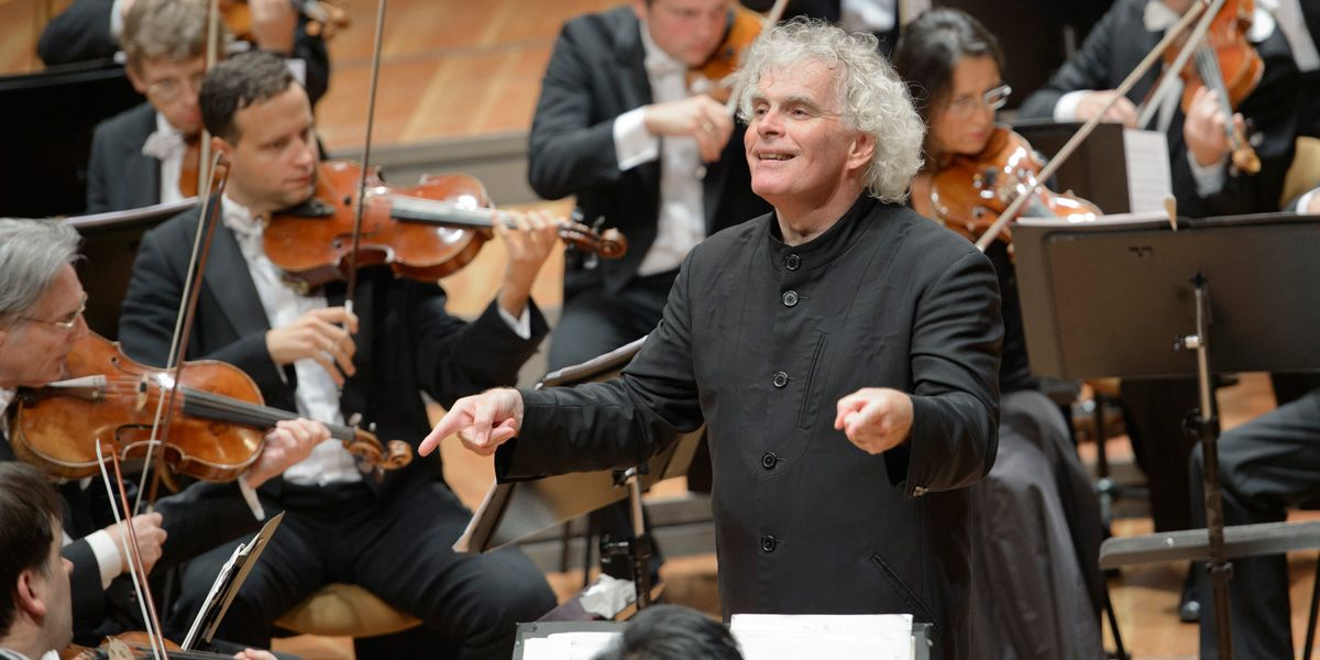 Sir Simon Rattle conducting