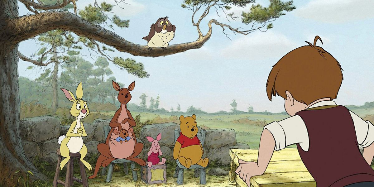 The friends gather to listen to Christopher Robin talk in Winnie the Pooh