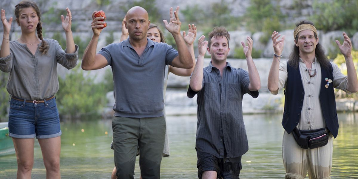 The gang pray in a river in Problemos
