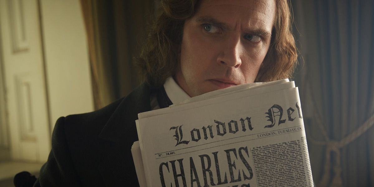 Charles Dicken holding a newspaper in The Man who Invented Christmas