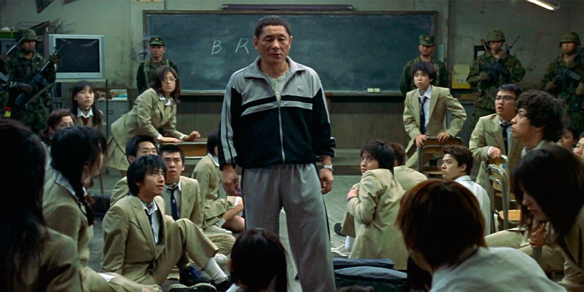 Takeshi Kitano standing in front of his students in Battle Royale