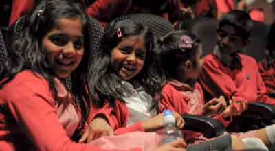 A photo of a group of children at a school screening for An Indian Summer festival