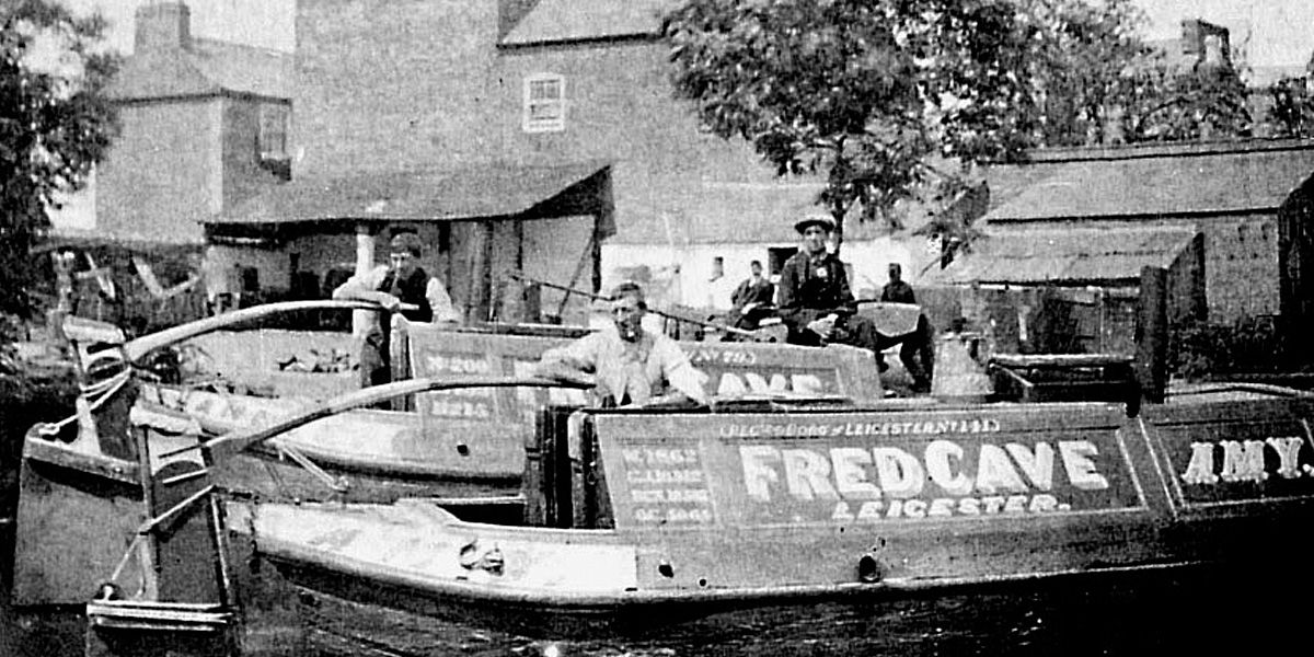 Men pose on their canal boats in archive footage